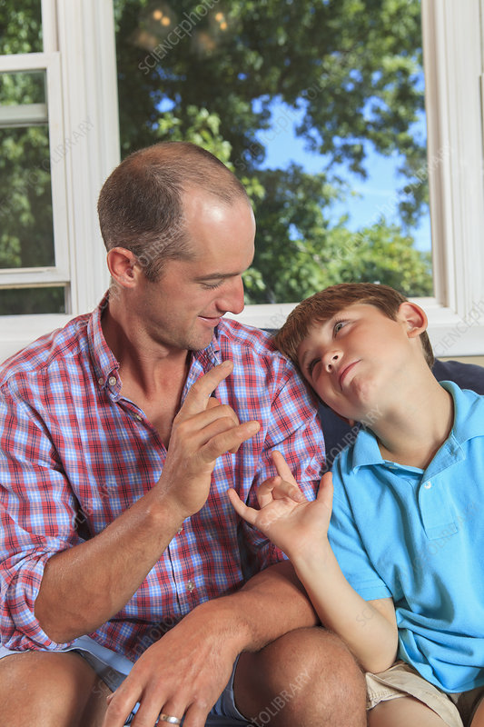 Father and sons with hearing impairments