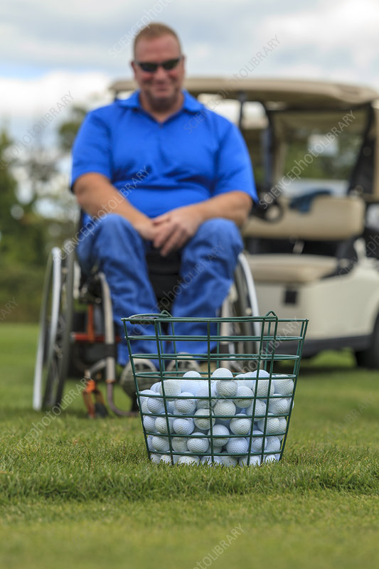 Man in wheelchair waiting to play golf