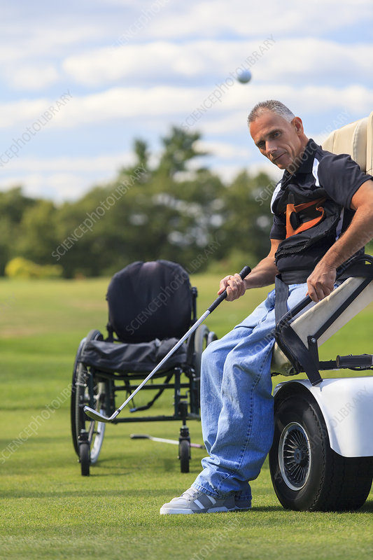 Man with disability playing golf in cart