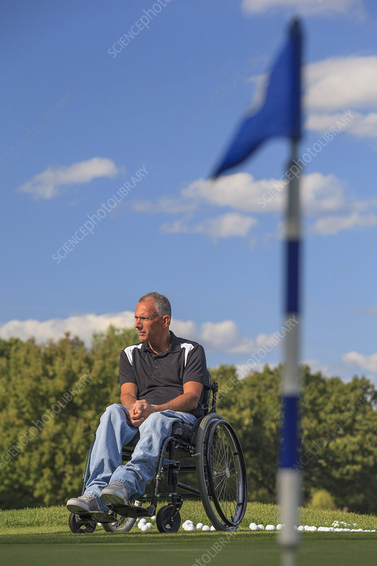 Man in a wheelchair waiting to play golf