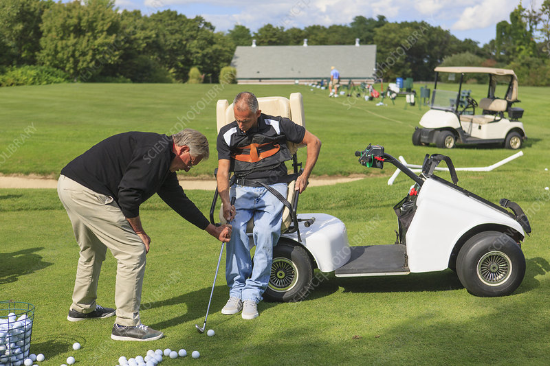 Men with disability playing golf in cart