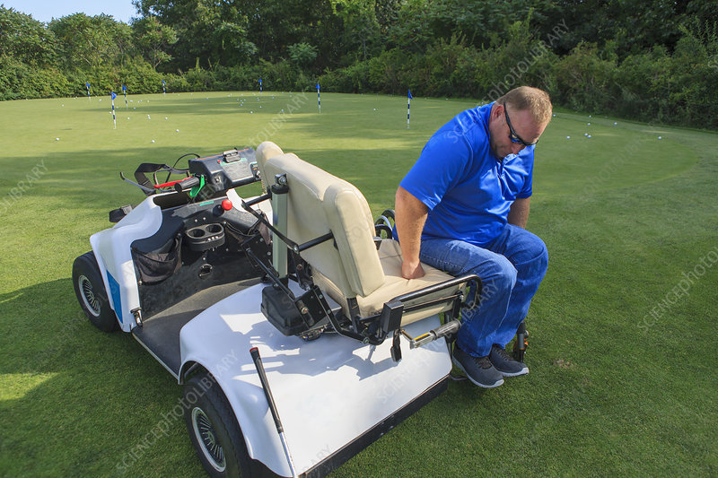 Men with disability in golf cart