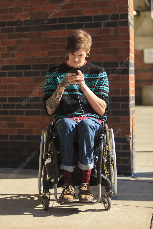 Man with in wheelchair taking messages