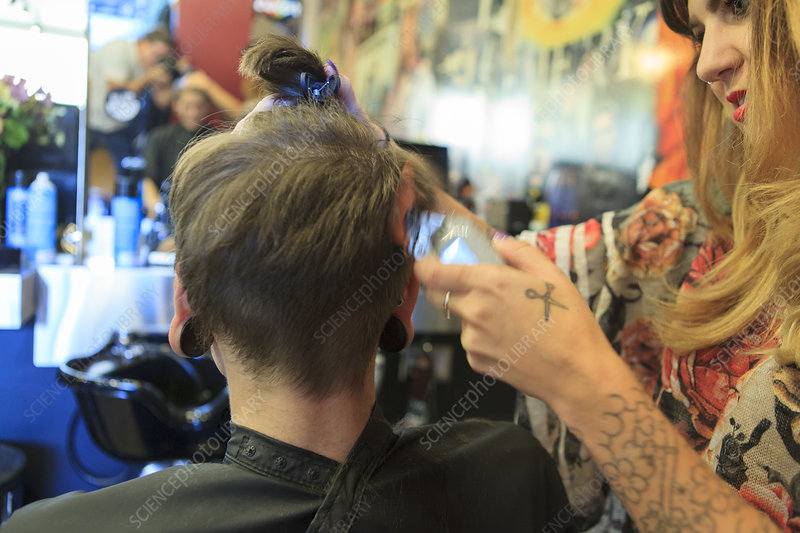 Man with spinal cord injury at hair salon