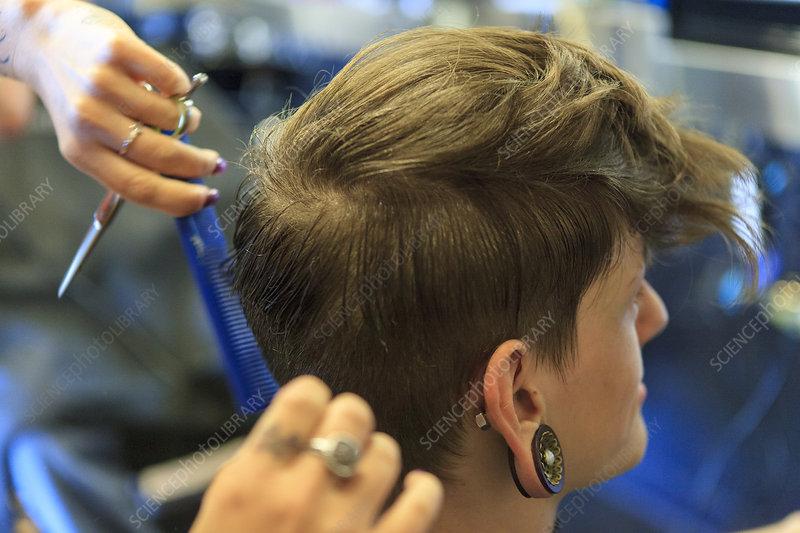 Man with spinal cord injury at hair salon