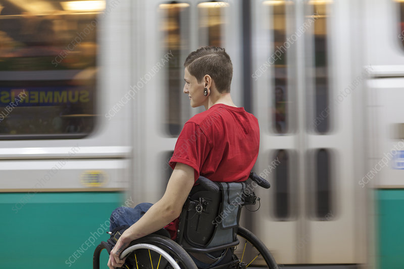 Man in wheelchair waiting for subway