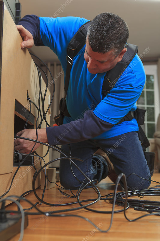 Cable installer working in a home