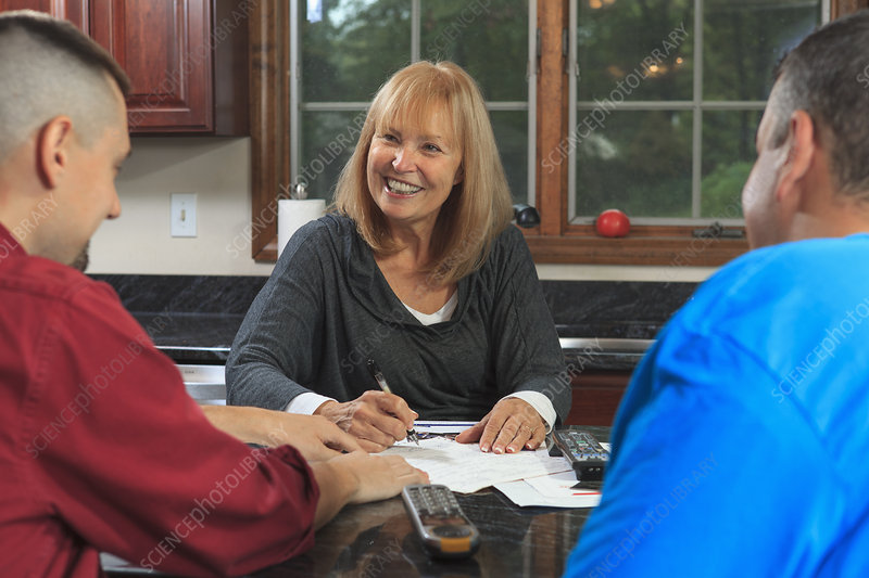 Home owner signing new service contract