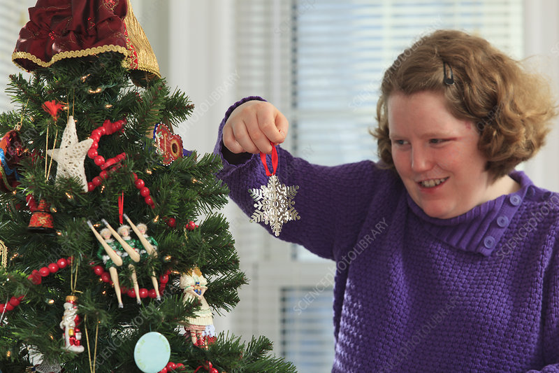 Autistic woman with Christmas tree