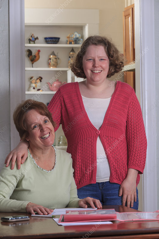 Mother helping autistic daughter