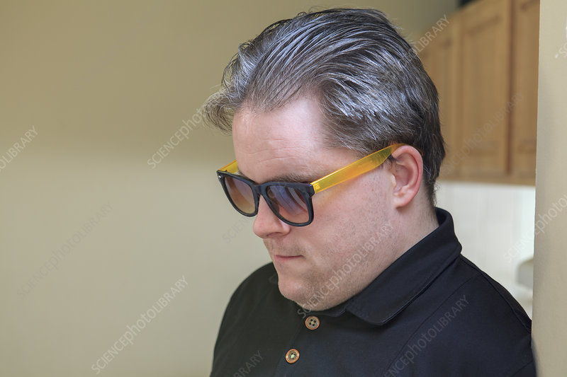 Blind man wearing glasses