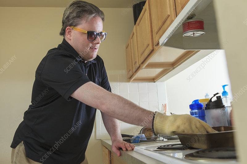 Blind man using his kitchen stove