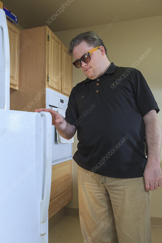 Blind man using the refrigerator