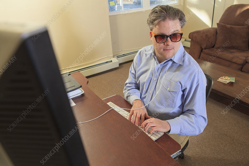 Blind man using his computer