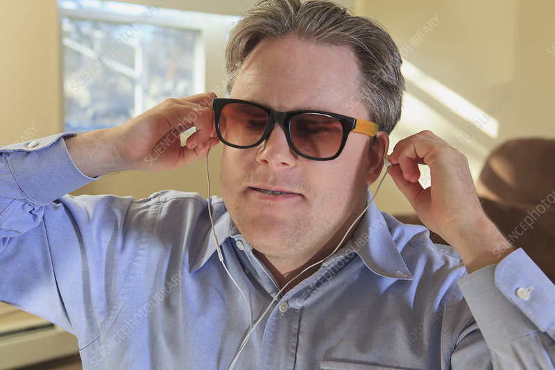 Blind man using assistive technology