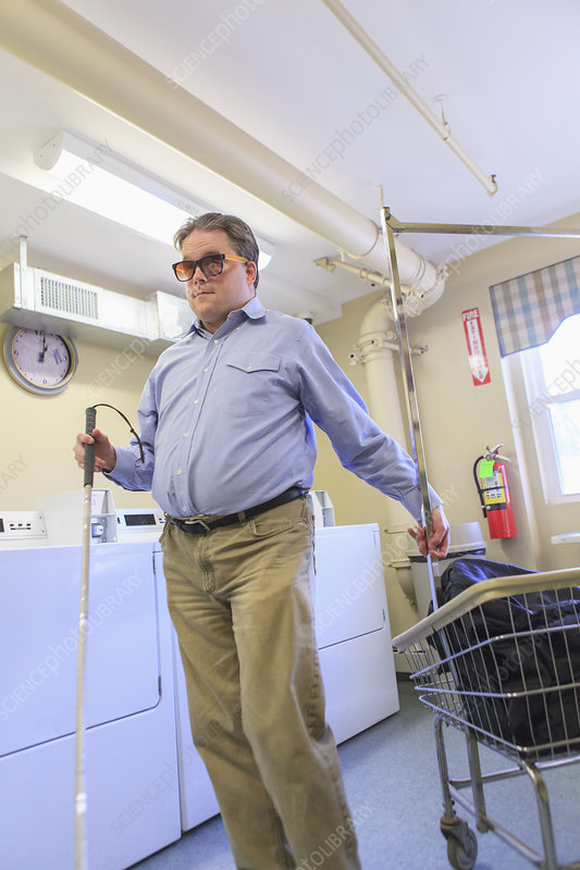 Blind man doing the laundry