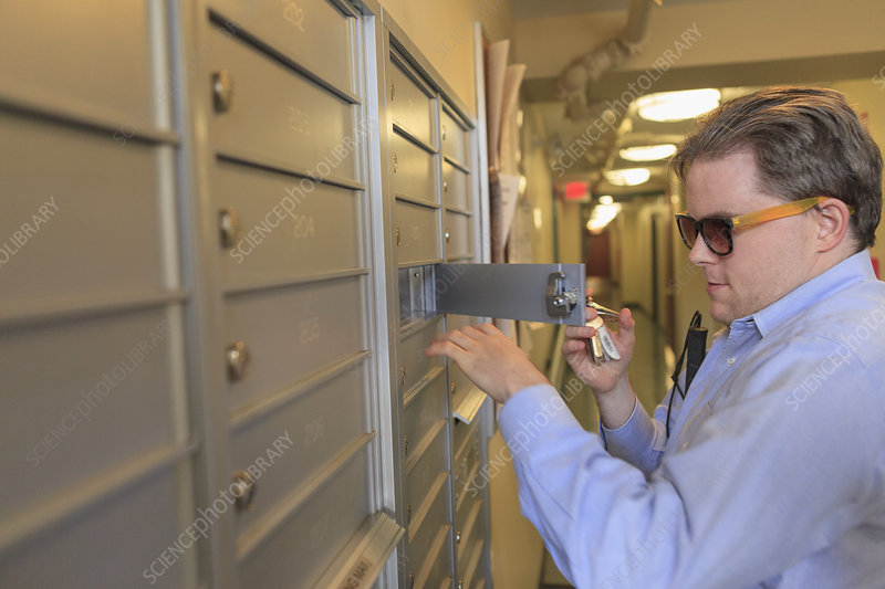 Blind man opening his mailbox