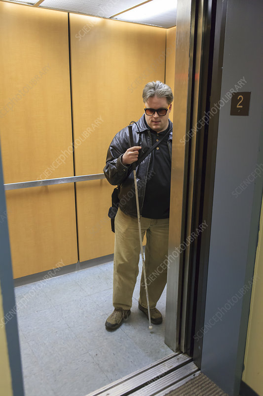 Blind man exiting an elevator