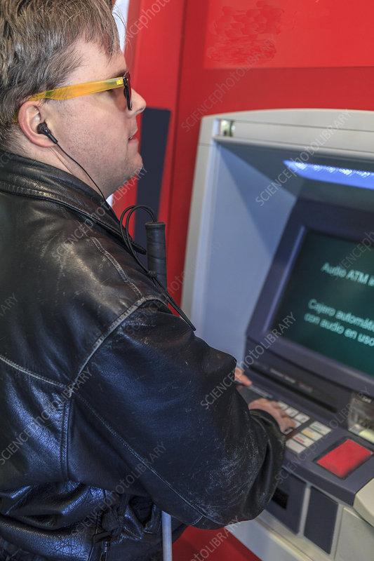 Blind man using an ATM