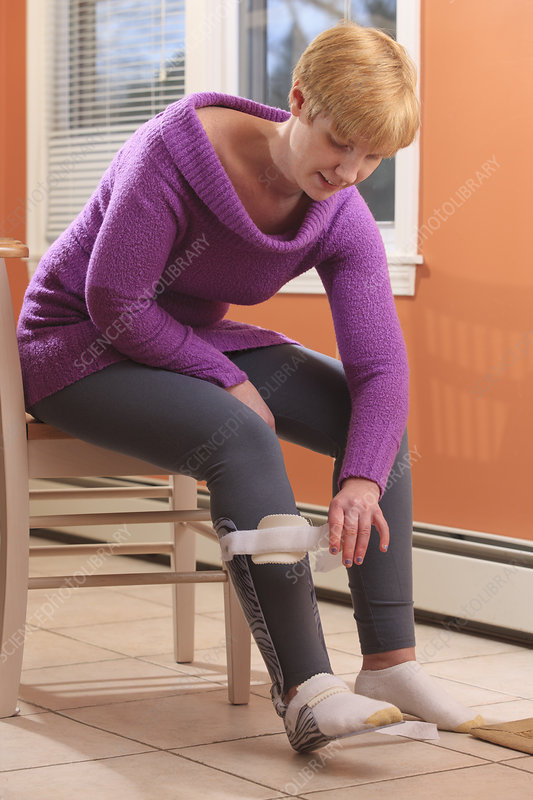 Woman putting a brace on her foot