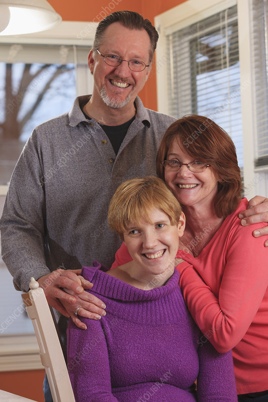 Visually impaired woman with her parents