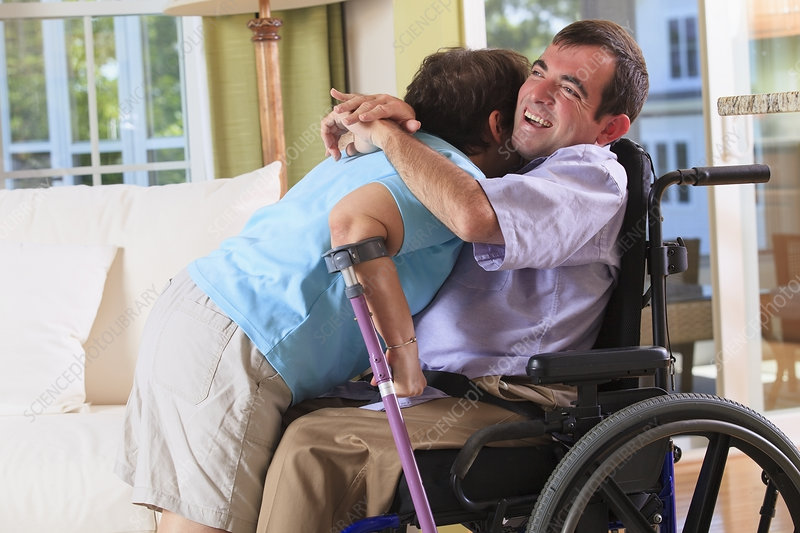 Couple with Cerebral Palsy hugging