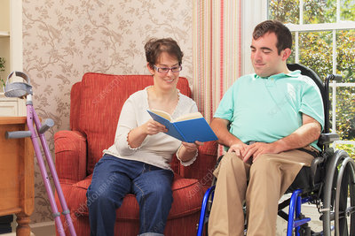 Couple with Cerebral Palsy reading