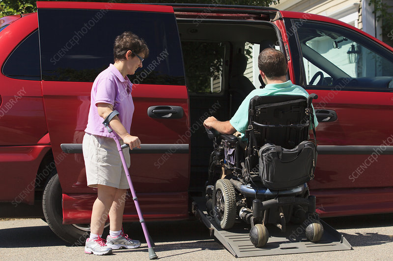 Couple with Cerebral Palsy with vehicle