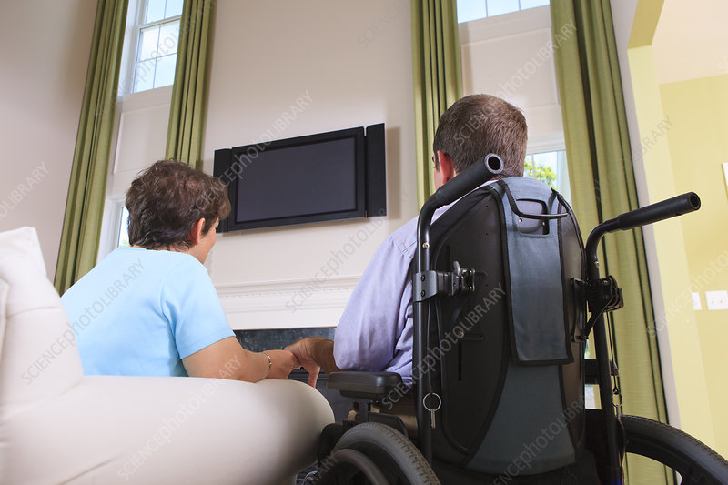Couple with Cerebral Palsy watching TV