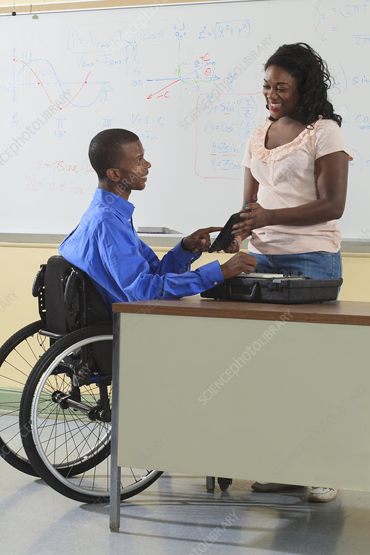 Two students, one in wheelchair