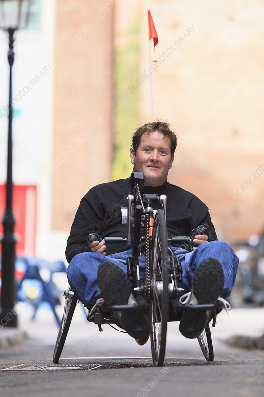 Man with spinal cord injury in hand cycle