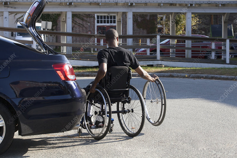 Man in wheelchair entering his vehicle