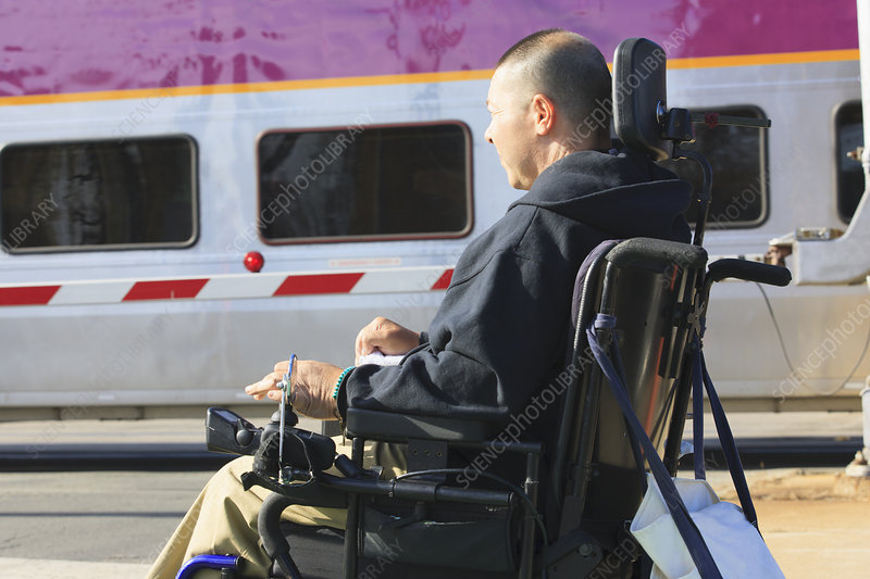 Man using his motorized wheelchair