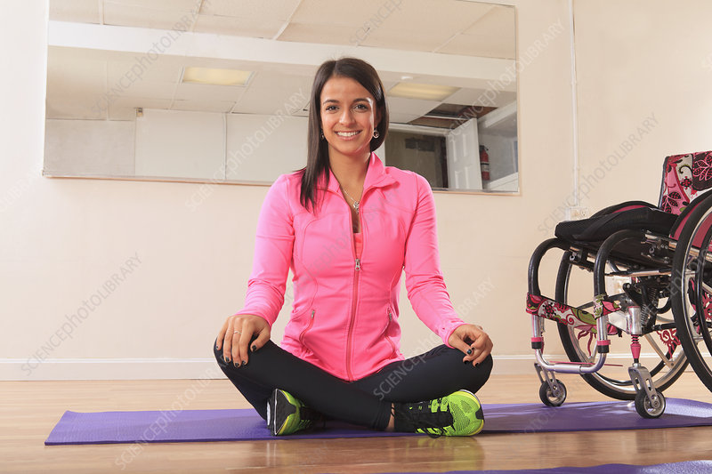 Woman with spinal cord injury doing yoga