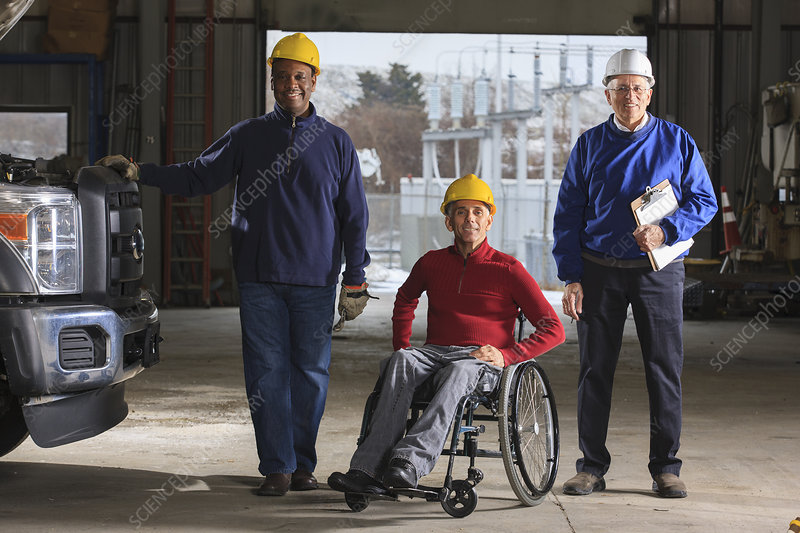 Power plant engineer, one in wheelchair