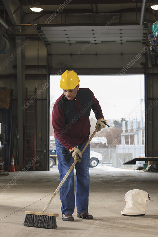 Maintenance supervisor cleaning garage