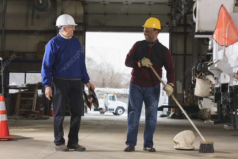 Maintenance supervisors cleaning garage