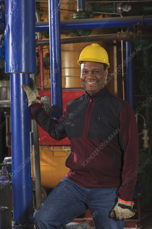 Power plant engineer in equipment room