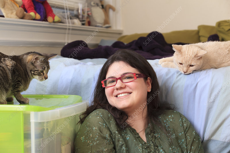 Woman with Asperger syndrome with cats