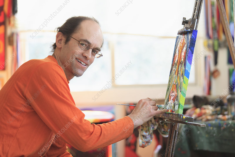 Man with Asperger syndrome in art studio