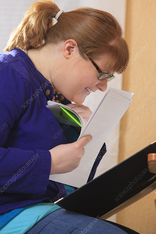 Visually impaired woman reading