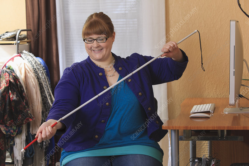Visually impaired woman using her cane