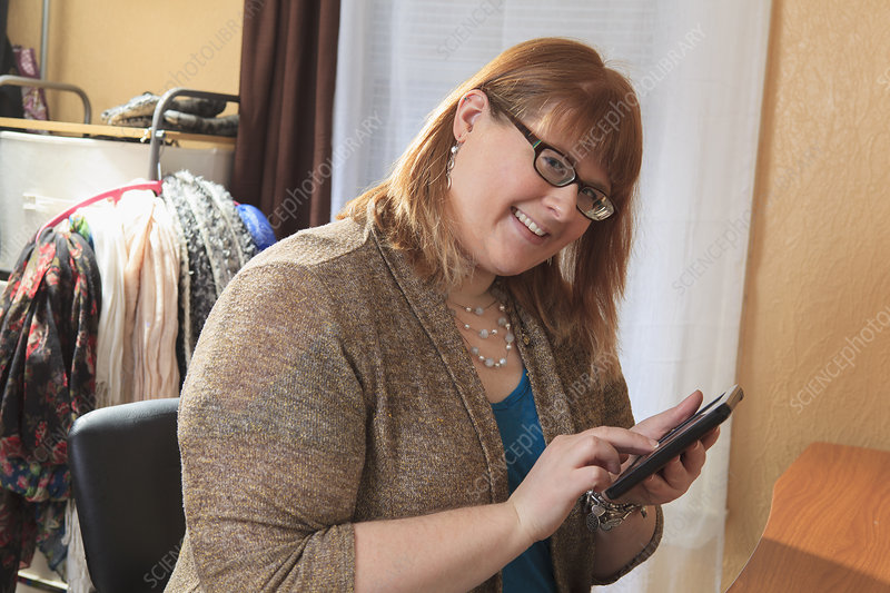 Visually impaired woman using tablet