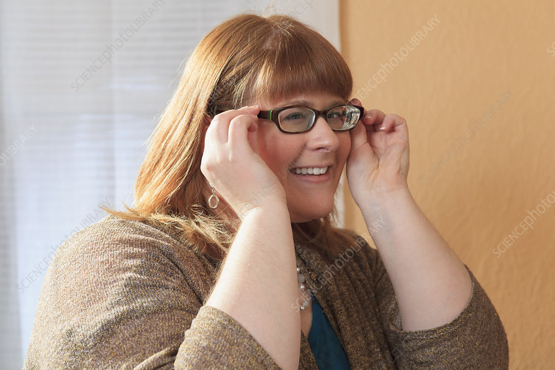 Visually impaired woman trying glasses