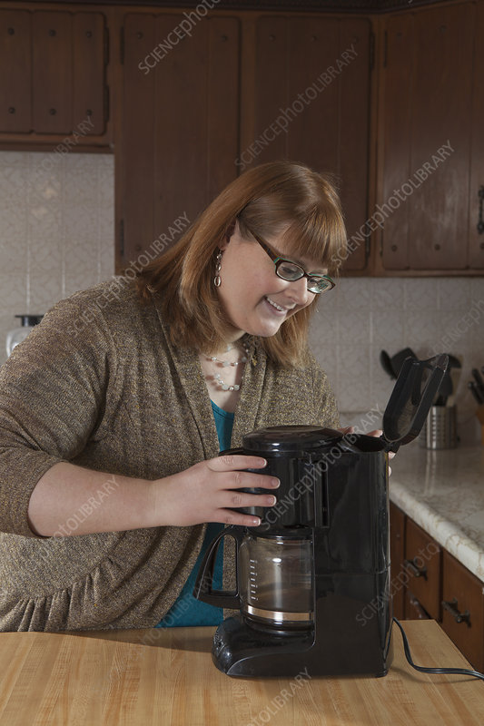 Visually impaired woman in the kitchen