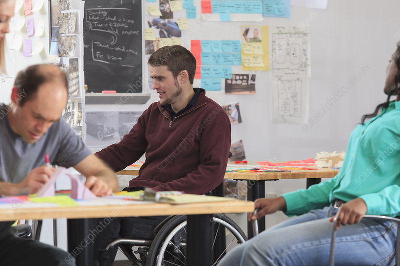 Student in wheelchair, man with Asperger