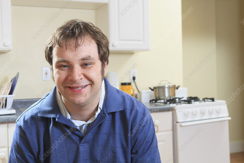Man with Asperger syndrome at home
