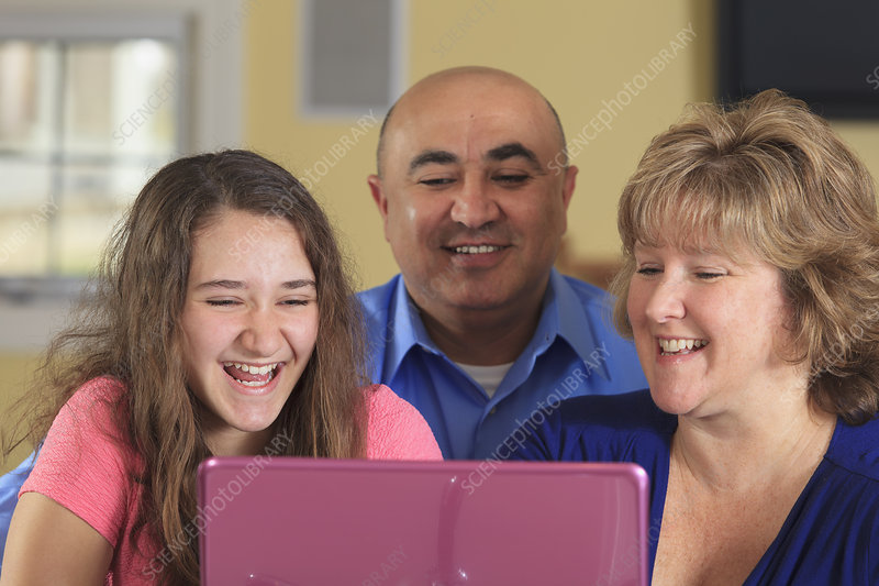 Daughter with father and mother laughing