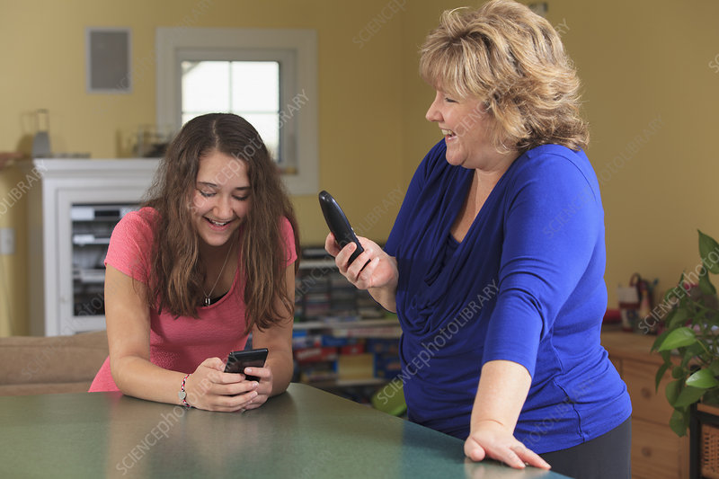 Mother and daughter laughing at messages
