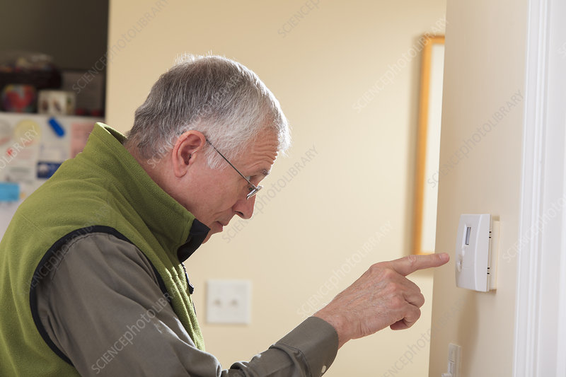Man setting home security system